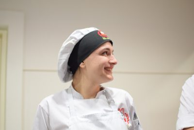 young woman chef, with hat, smile
